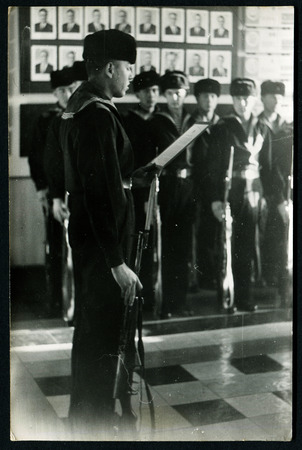 allegiance: Ussr - CIRCA 1950s: An antique Black & White photo show soldier sailor takes the oath of allegiance