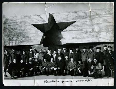 USSR - CIRCA 1974: An antique photo shows Group of tourists on the background of the Brest Fortress, USSR, circa 1974