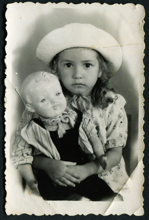 USSR - CIRCA 1980s: Portrait of little girl in a hat with a toy, circa 1980s