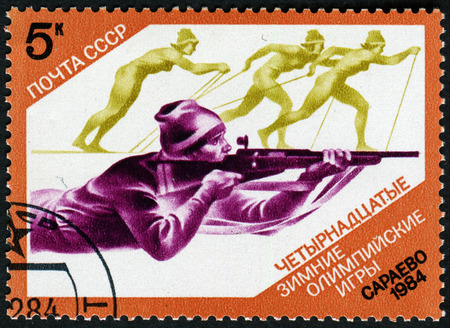 olympiad: USSR - CIRCA 1984: Postage stamps printed in the USSR, shows the XIV Olympic Winter Games in Sarajevo, biathlon, circa 1984 Editorial