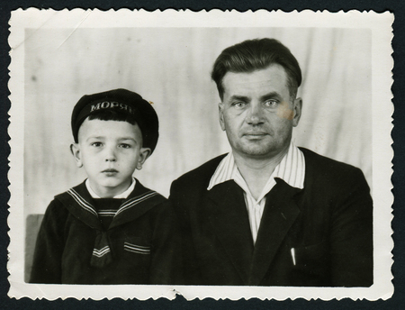 Ussr - CIRCA 1970s: An antique Black & White photo shows studio portrait of father and son