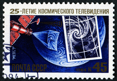 astronautics: USSR - CIRCA 1984: a stamp printed by USSR shows Meteor Satellite, Television of Space, 25th anniversary, circa 1984.