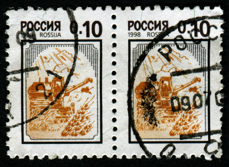 RUSSIA - CIRCA 1998: A stamp printed in Russia shows harvesting, circa 1998