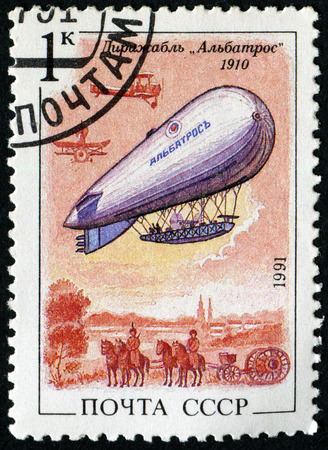 stamp collecting: USSR- CIRCA 1991: A stamp printed in USSR shows Airship,plane and army(First World War) , circa 1991. Editorial