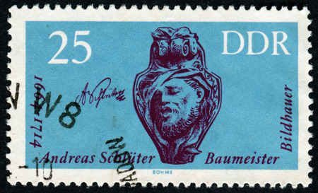pseudonym: Germany - CIRCA 1988: A stamp printed in the Germany, shows the portrait Andreas Schluter: German Baroque Sculptor and Architect, circa 1988