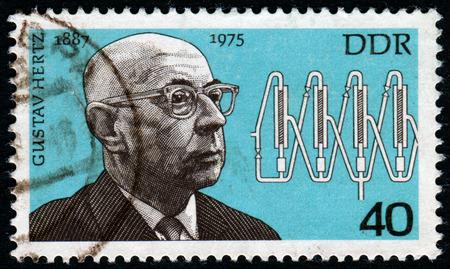 pseudonym: GERMANY- CIRCA 1977: stamp printed in Germany, shows Gustav Ludwig Hertz, circa 1977.