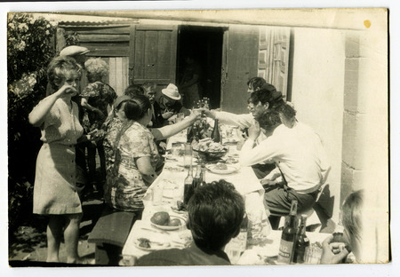 feast: Ussr - CIRCA 1980s: An antique Black & White photo show feast outdoors