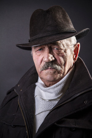 aging american: Studio portrait of an expressive old man