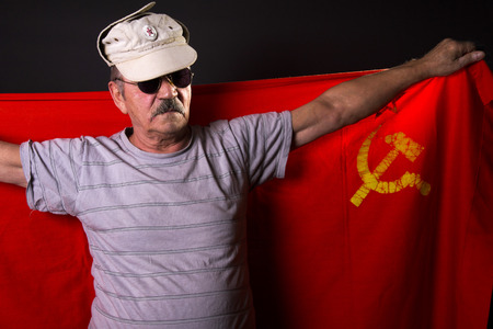 old man patriot with flag of the USSR