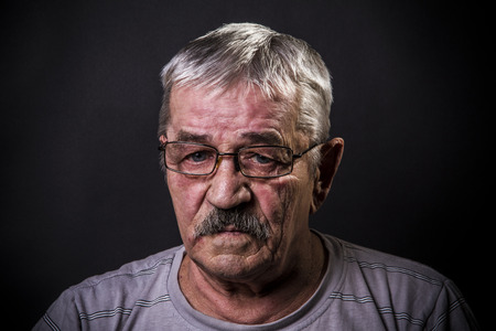 old man in glasses with sad eyes Stock Photo