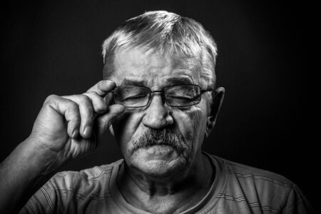 eye's closed: portrait of an old man in glasses with eyes closed