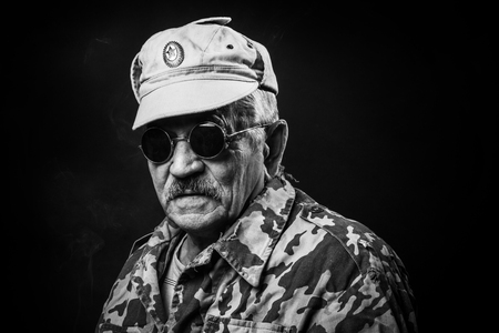 old military with glasses smoking a cigarette Stock Photo