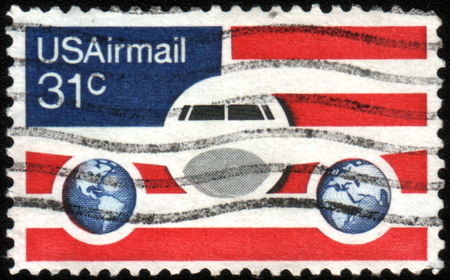 USA-CIRCA 1976: A 31 cent United States Airmail postage stamp, shows image of Plane and Globes on red white and blue background, circa 1976.