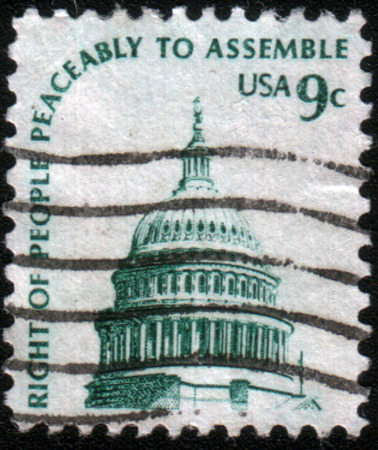 peaceably: USA - CIRCA 1975: A greeting stamp printed in United States of America shows Dome of Capitol, in-script Right of people peaceably to assemble, circa 1975