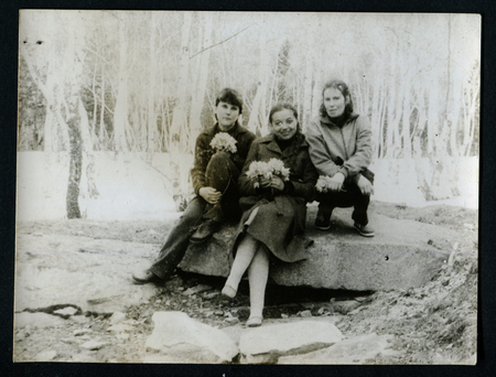generational: USSR - CIRCA 1970s: An antique photo shows three women sitting on a rock in the forest