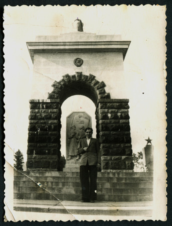 solders: USSR - CIRCA 1960s: An antique photo shows man on the background of the monument to the soldiers, USSR, circa 1960s