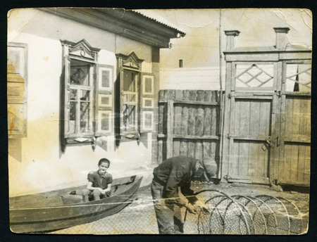 xx century: Ussr - CIRCA 1950s: An antique Black & White photo show fisherman unravels fishing nets
