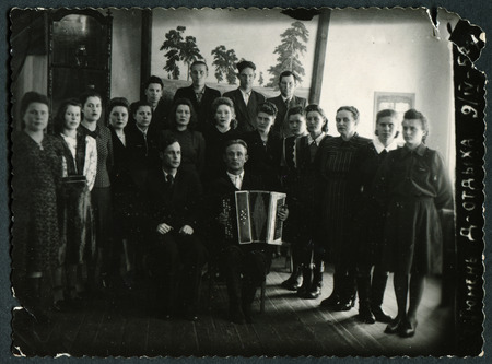 generational: Ussr - CIRCA 1930s: An antique Black & White photo show Group travelers. Caption for photo: Tyumen, Holiday House