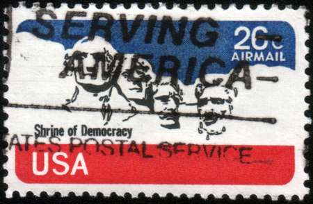 theodore roosevelt: USA-CIRCA 1974: A stamp printed in USA shows stone sculptures of George Washington, Thomas Jefferson, Theodore Roosevelt, and Abraham Lincoln, circa 1974