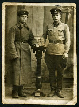studio b: USSR - CIRCA 1930s: Vintage photo shows studio portrait of two Red Commanders, 1930s