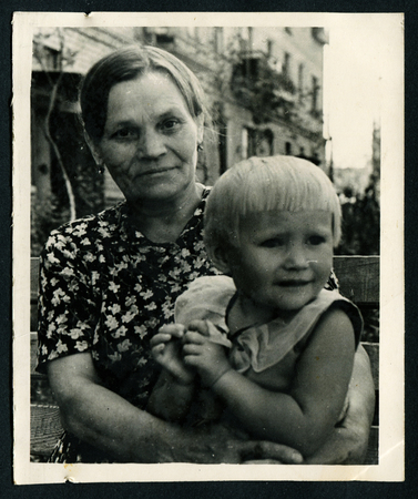 origin of man: Ussr - CIRCA 1980s: An antique Black & White photo show mother and daughter