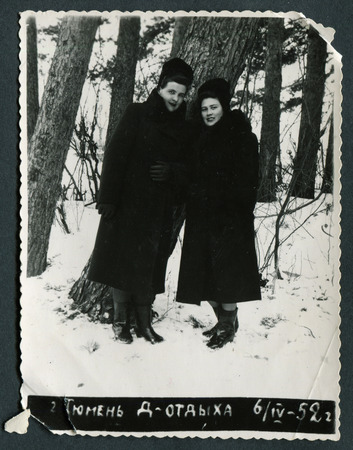 edwardian: Ussr - CIRCA 1952: An antique Black & White photo show Two young women in the forest at a spa in Tyumen