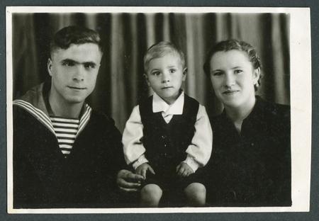 Ussr - CIRCA 1970s: An antique Black & White photo show family portrait Editorial