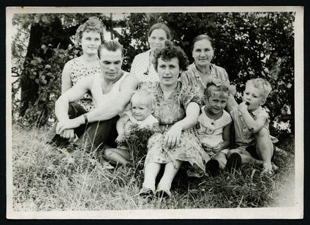 xx century: Ussr - CIRCA 1970s: An antique Black & White photo show family in the countryside