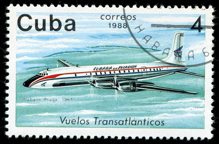habana: CUBA - CIRCA 1988: A Stamp printed in CUBA shows image of airplane, with inscription Habana - Prague, 1961, from the series Cubana Airlines Transatlantic Flights, circa 1988