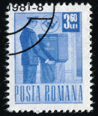 posthorn: ROMANIA - CIRCA 1971: A stamp printed in Romania shows a postman collecting the mail, circa 1971. Editorial