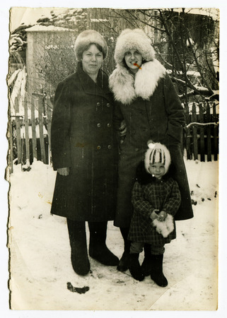 dictate: USSR - CIRCA 1970s: An antique photo shows Two women and a little boy, circa 1970s Editorial