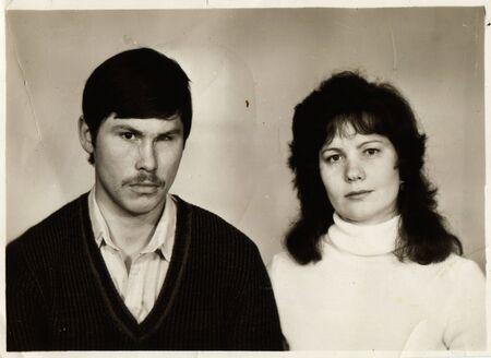 bureaucrat: USSR - CIRCA 1960s : An antique photo shows studio portrait of a mature man and a woman - a married couple.