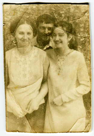 Ussr - CIRCA 1930s: An antique Black & White photo show two young woman and boy