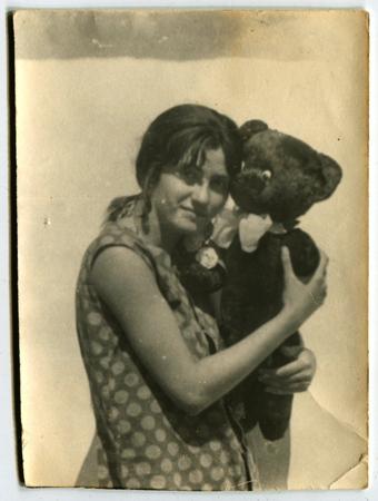 xx century: Ussr - CIRCA 1970s: An antique Black & White photo show girl with teddy bear