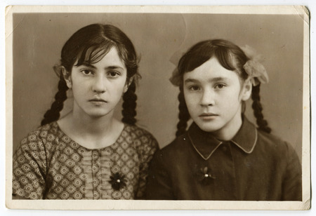 CZECHOSLOVAKIA - CIRCA 1950s: An antique Black & White photo show Two young girlfriends