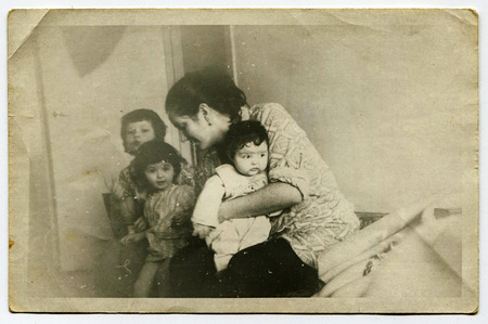 saddened: Ussr - CIRCA 1970s: An antique Black & White photo show mother with three children