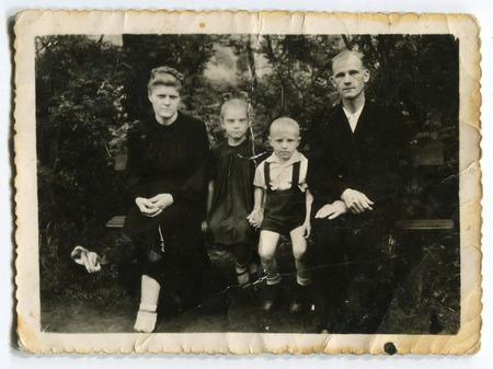 origin of man: Ussr - CIRCA 1950s: An antique Black & White photo show family portrait