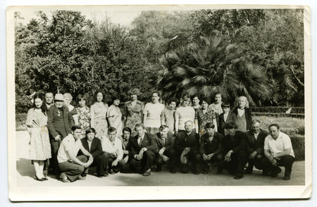 archival: USSR - 1980s: An antique photo shows a group of tourists in the botanical garden