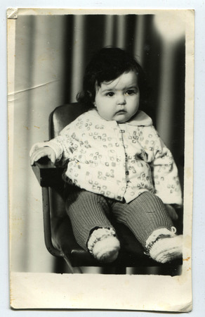antique chair: Ussr - CIRCA 1970s: An antique Black & White photo little girl on the chair Editorial
