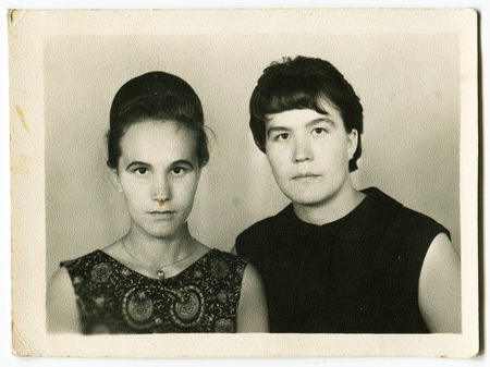 timidity: Ussr - CIRCA 1950s: An antique Black & White photo show two womens