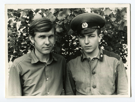 Ussr - CIRCA 1990s: An antique Black & White photo show two soldier