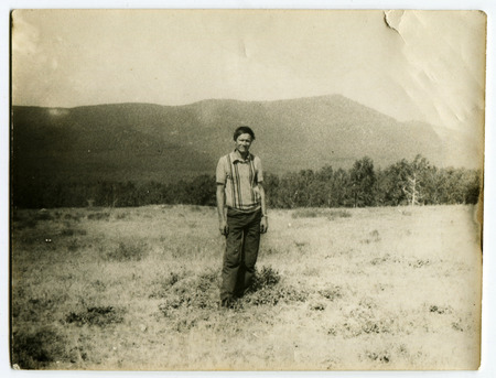 old photograph: USSR - CIRCA 1970s: An antique photo shows male mountains in the background, USSR, circa 1970s