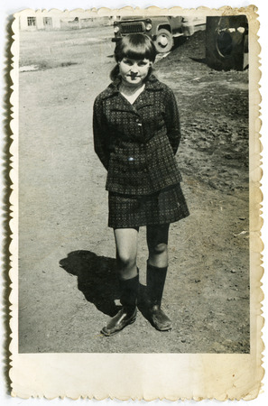 circa: USSR - CIRCA 1980s: An antique photo show girl walking on the street, USSR, circa 1980s Editorial