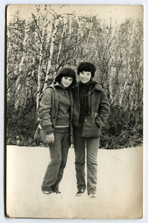 the ussr: USSR - CIRCA 1960s: An antique photo shows two girls in the winter forest, USSR, circa 1960s