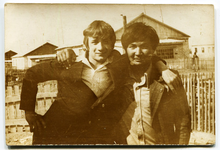 the ussr: USSR - CIRCA 1970s: An antique photo shows two young men in an embrace, USSR, circa 1970s