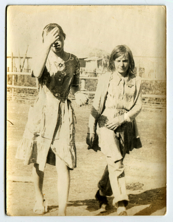 the ussr: USSR - CIRCA 1960s: An antique photo shows Two young girls walk down the street, USSR, circa 1960s Editorial