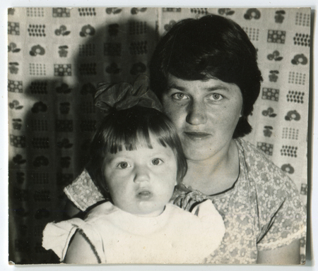 the ussr: USSR - CIRCA 1980s: An antique photo shows  mom and little daughter, USSR, circa 1980s
