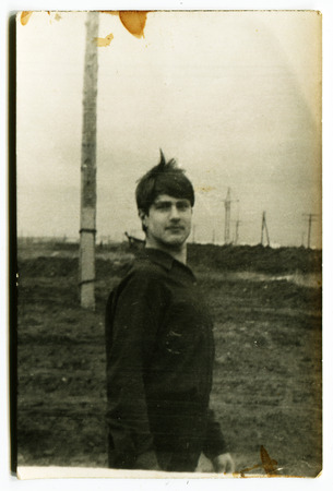 Ussr - CIRCA 1970s: An antique Black & White photo show portrait of a young man 新聞圖片