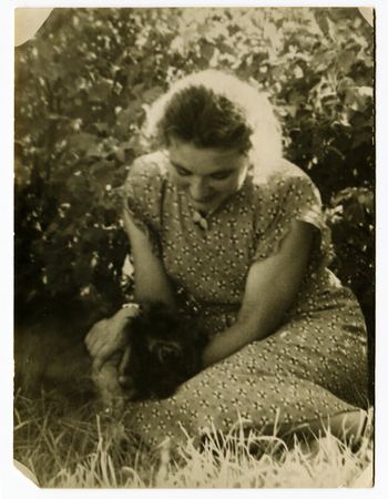Ussr - CIRCA 1970s: An antique Black & White photo show young woman in the garden