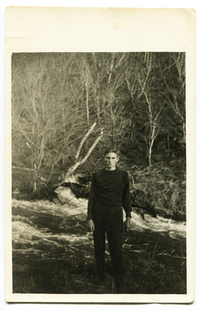 Ussr - CIRCA 1970s: An antique Black & White photo show man on the river bank 新聞圖片
